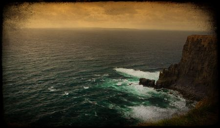 moher: photo grunge sunset by the cliffs of moher, ireland Stock Photo
