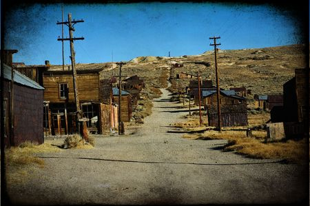 photo grunge texture of a western ghost town Standard-Bild
