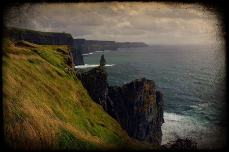 photo grunge scenic sunset view of the cliffs of moher, ireland photo