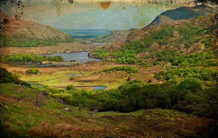 photo grunge of a scenic landscape with lake and mountains photo