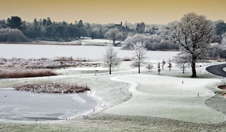 photo winter cold scenic landscape lake with castle in distance, ireland photo