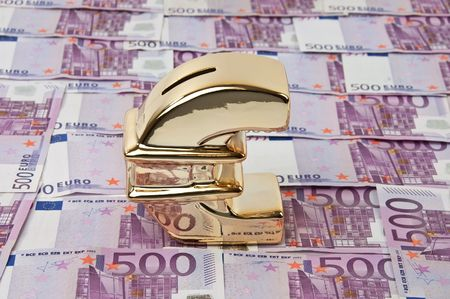 photo of 500 euro bills and gold euro sign photo