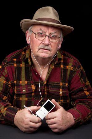 senior male listening to mp3 music player photo