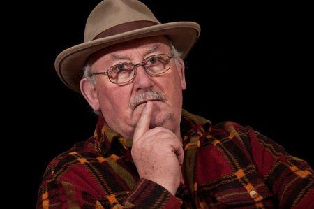 senior male portrait closeup on black background photo