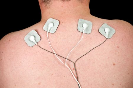 stimulation: photo male with acute neck pain, electrodes to tens unit Stock Photo