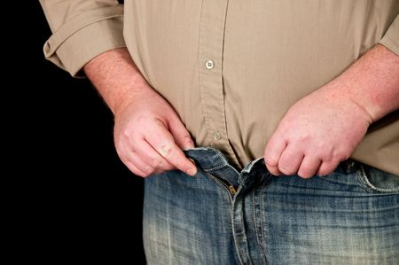 photo of male in jeans open waistline on black background Stock Photo