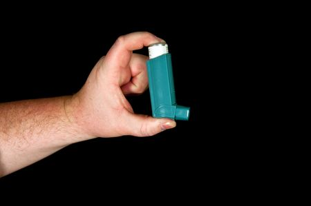 photo of fat male with inhaler asthma on black background