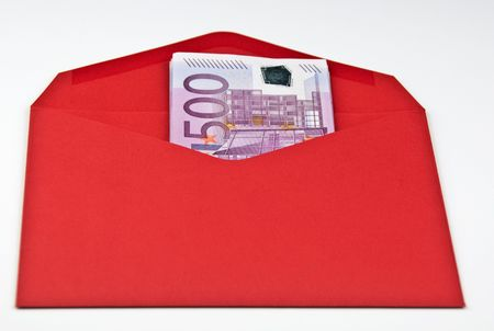 red envelope blank with 500 euro cash on white photo