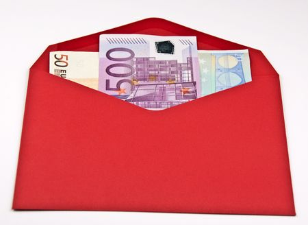red envelope blank with 500,50,20 euro cash on white photo
