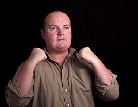 angry overweight male on black background photo