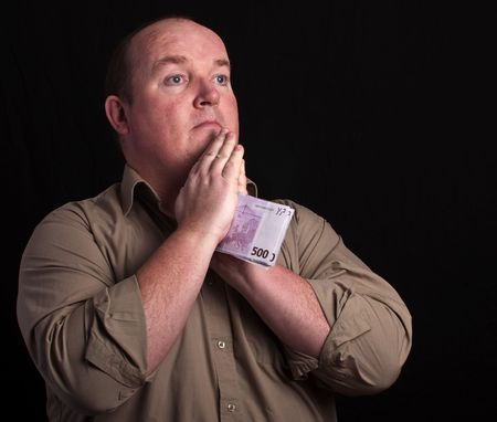 portrait of male praying on black background photo