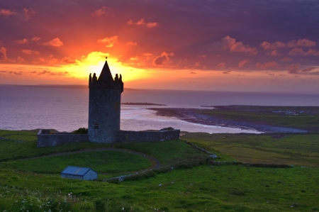 sunset of a ancient castle in the west coast of ireland