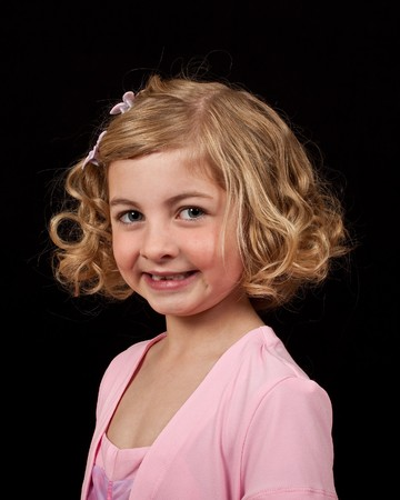 photo portrait of a young girl in a pink dress photo
