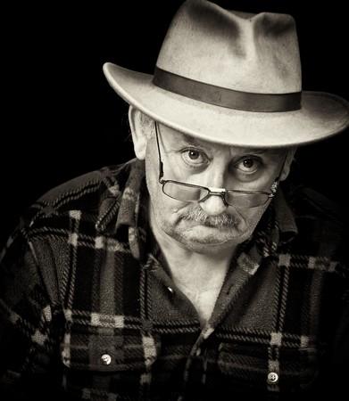 grumpy old man: senior male with sad or grumpy face portrait