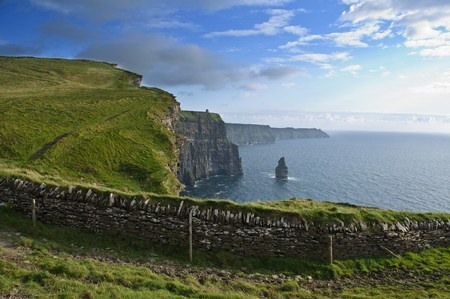 photo famous cliffs of moher, castle tower, west coast of ireland photo
