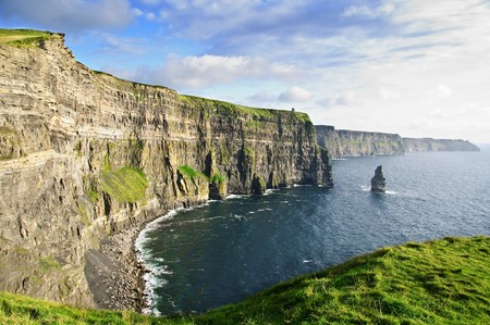moher: photo famous cliffs of moher, castle tower, west coast of ireland