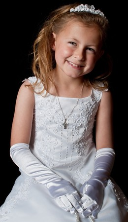 photo smiling young girl in white dress on black
