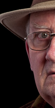 grumpy old man: photo senior male retired wearing glasses and hat