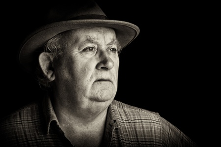 senior male retired wearing a hat on black Stock Photo - 9062021