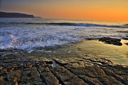 photo breathtaking sunset over doolin beach, county clare, ireland, hdr photo