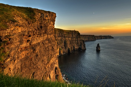 photo famous cliffs of moher, sunset, county clare, ireland Stock Photo