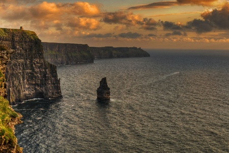 photo famous cliffs of moher, sunset, county clare, ireland photo