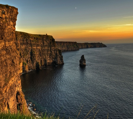 moher: photo famous cliffs of moher, sunset, county clare, ireland Stock Photo