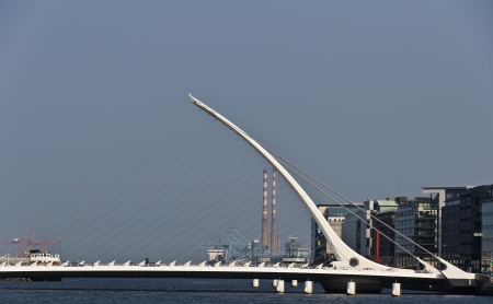 The Samuel Beckett Bridge crosses the Liffey River in Dublin  The structure, designed with a cable-stay method of suspension, is said to resemble an Irish harp   photo