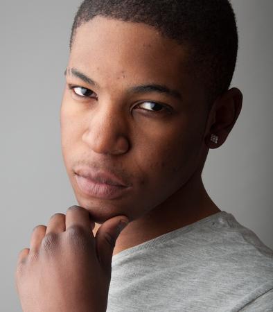 late 20s: Close up Headshot portrait of a handsome black man.