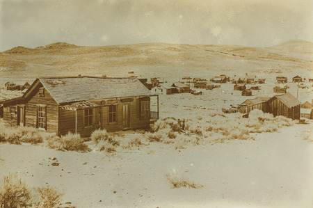 see the usa: Aged sepia digital grunge distressed effect Bodie State Historic Park.