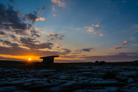 burren: 5000 years old Polnabrone Dolmen in Burren, National Park Sunset Landscape, County. Clare - Ireland Stock Photo
