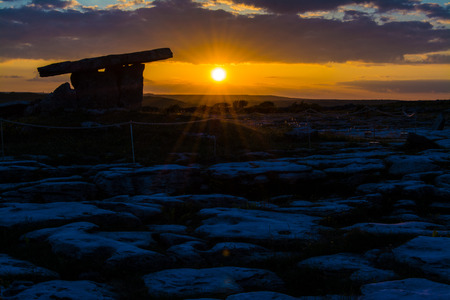 stoneage: 5000 years old Polnabrone Dolmen in Burren, National Park Sunset Landscape, County. Clare - Ireland Stock Photo