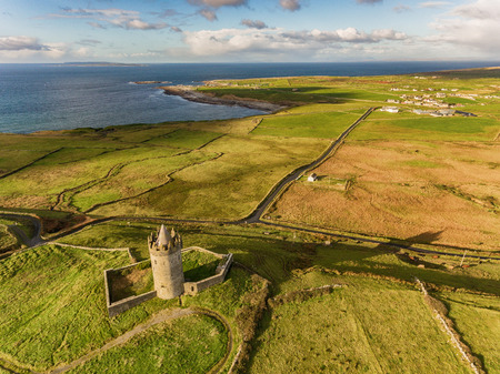 aran: Aerial Famous Irish Tourist Attraction In Doolin, County Clare, Ireland. Doonagore Castle is a round 16th-century tower Castle. Aran Islands and along The Wild Atlantic Way.
