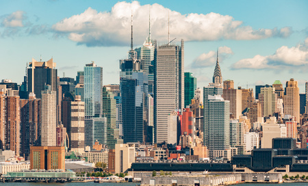 hudson: new york skyline over manhattan midtown. beautiful nyc city skyline on hudson with old sailing boats ships. Stock Photo