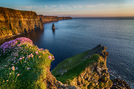 irish landscape: Ireland countryside tourist attraction in County Clare. The Cliffs of Moher and castle Ireland. Epic Irish Landscape Seascape along the wild atlantic way. Beautiful scenic nature hdr Ireland.