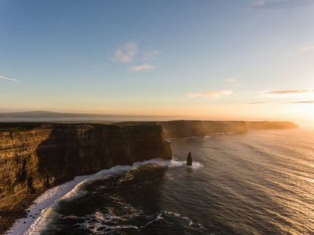 irish landscape: Aerial Ireland countryside tourist attraction in County Clare. The Cliffs of Moher sunset and castle Ireland. Epic Irish Landscape along the wild atlantic way. Beautiful scenic irish nature. Stock Photo