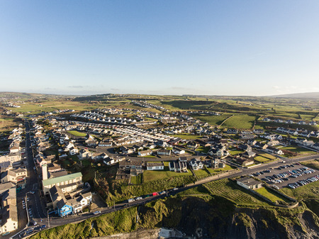 irish landscape: Aerial view of Irelands top surfing town and beach in Ireland. Lahinch Lehinch town and beach in county clare. Beautiful scenic rural countryside in ireland.