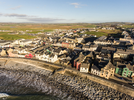 irish countryside: Aerial view of Irelands top surfing town and beach in Ireland. Lahinch Lehinch town and beach in county clare. Beautiful scenic rural countryside in ireland.