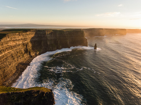 cliffs: Aerial Ireland countryside tourist attraction in County Clare. The Cliffs of Moher sunset and castle Ireland. Epic Irish Landscape along the wild atlantic way. Beautiful scenic irish nature. Stock Photo