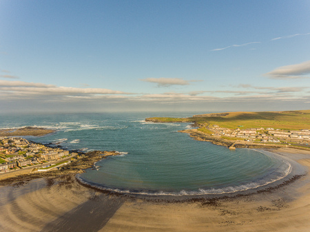 irish countryside: west coast of ireland top summer beach. kilkee beach and town in county clare. scenic kilkee on a sunny day. aerial view.