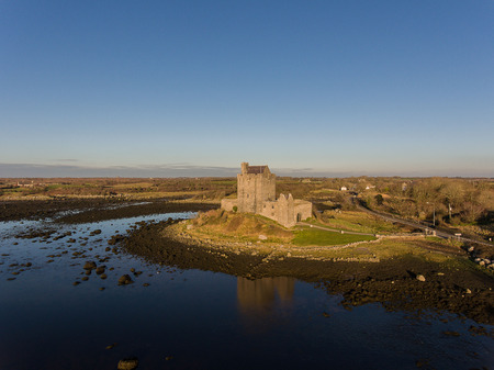 Aerial Dunguaire Castle Evening Sunset, near Kinvarra in County Galway, Ireland - Wild Atlantic Way Route. Famous public tourist attraction in Ireland. Stock Photo