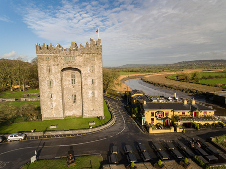 west river: Bunratty Castle and Durty Nellys Irish Pub, Ireland - Jan 31st 2017: Aerial view of Irelands most famous Castle and Irish Pub in County Clare. Famous world tourist attraction. Bunratty Castle and Durty Nellys Pub.