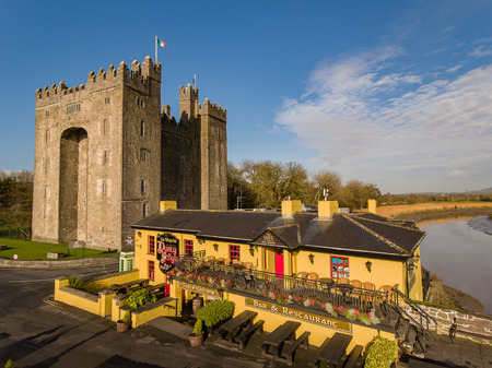 Bunratty Castle and Durty Nellys Irish Pub, Ireland - Jan 31st 2017: Aerial view of Irelands most famous Castle and Irish Pub in County Clare. Famous world tourist attraction. Bunratty Castle and Durty Nellys Pub.