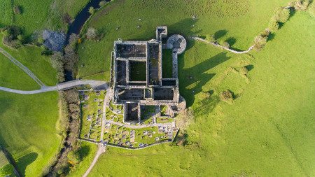 quin: Aerial view of an Irish public free tourist landmark, Quin Abbey, County clare, Ireland. Aerial landscape view of this beautiful ancient celtic historical architecture in county clare ireland.