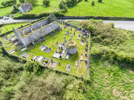 Aerial view of a beautiful old ruins of an Irish church and burial graveyard in county clare, Ireland. Set in the burren national park countryside landscape. Stock Photo
