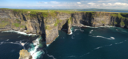 World famous birds eye aerial drone view of the Cliffs of Moher in County Clare, Ireland. Beautiful Irish Countryside Landscape on the Wild Atlantic Way route. Zdjęcie Seryjne - 81241555