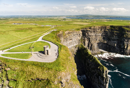 World famous birds eye aerial drone view of the Cliffs of Moher in County Clare, Ireland. Beautiful Irish Countryside Landscape on the Wild Atlantic Way route.