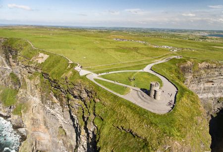 doolin: World famous birds eye aerial drone view of the Cliffs of Moher in County Clare, Ireland. Beautiful Irish Countryside Landscape on the Wild Atlantic Way route.