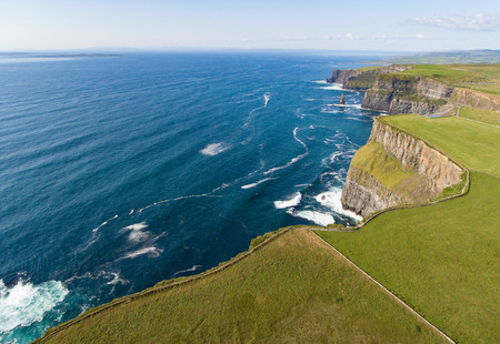 Aerial birds eye view from the world famous cliffs of moher in county clare ireland. beautiful irish scenic landscape nature in the rural countryside of ireland along the wild atlantic way.