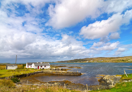 irish countryside: beautiful old irish cottage by the sea. cottage set in a scenic rural irish countryside. Stock Photo